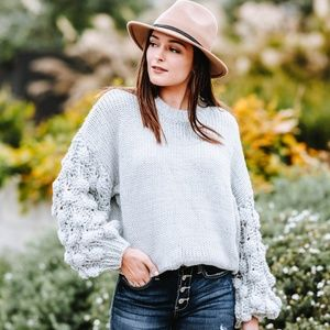 Textured Sleeve Pom Pom Sweater